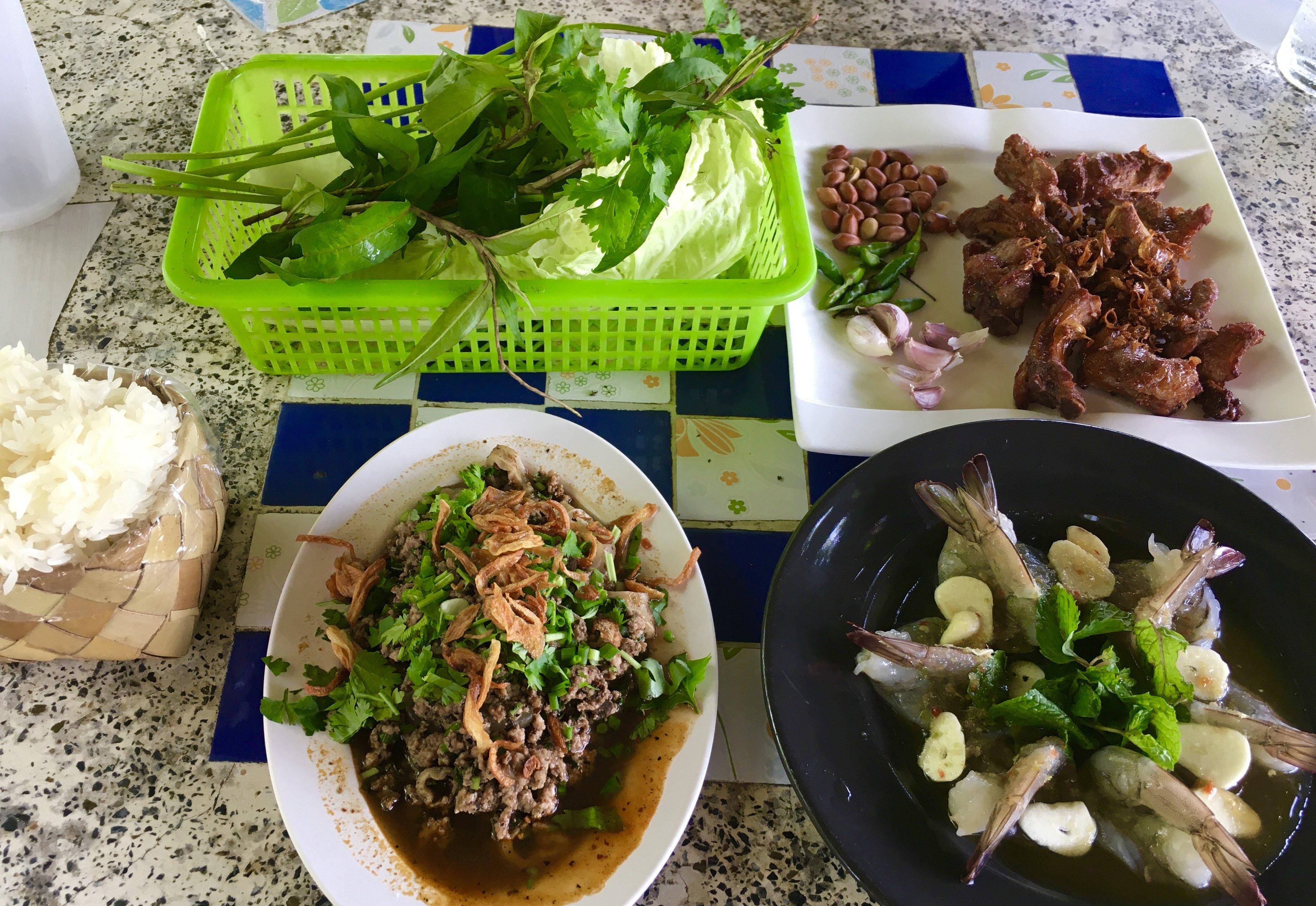 Pork laab, sour ribs, and raw shrimp with garlic at Laab Rim Na Restaurant - Pa Pong, Doi Saket